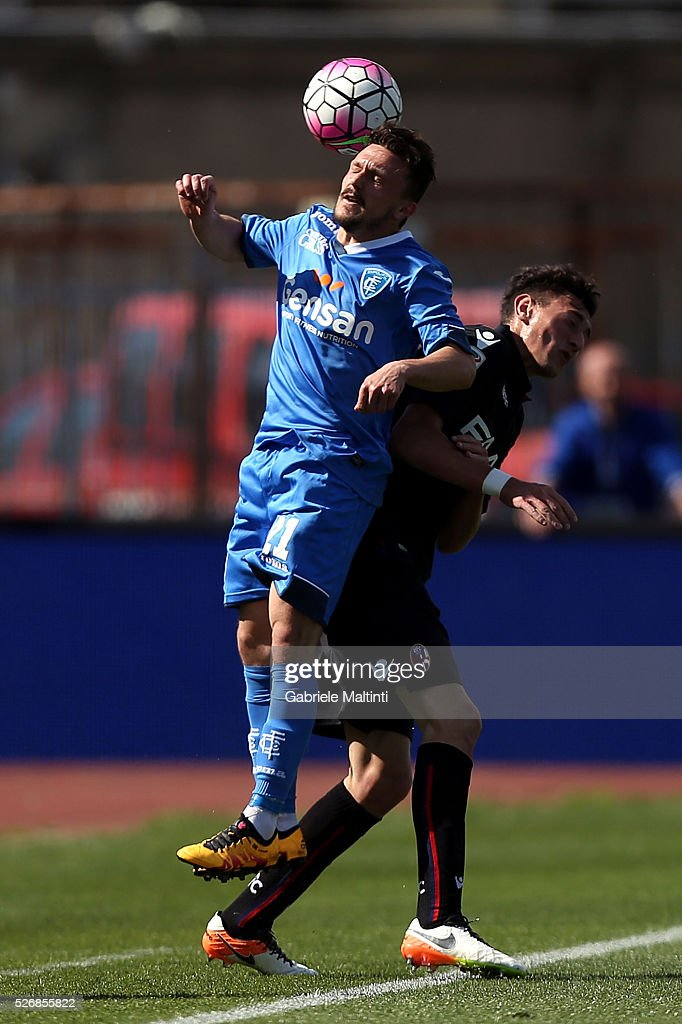 Mario Rui of Empoli FC battles for the ball with Alex Ferrari of Bologna Fc during the Serie A match between Empoli FC and Bologna FC at Stadio Carlo Castellani on May 1, 2016 in Empoli, Italy.