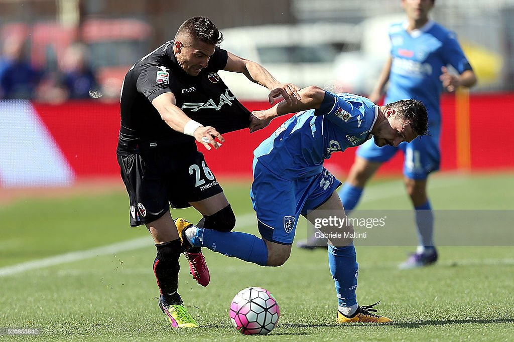 Mario Rui of Empoli FC battles for the ball with Anthony Mounier of Bologna Fc during the Serie A match between Empoli FC and Bologna FC at Stadio Carlo Castellani on May 1, 2016 in Empoli, Italy.