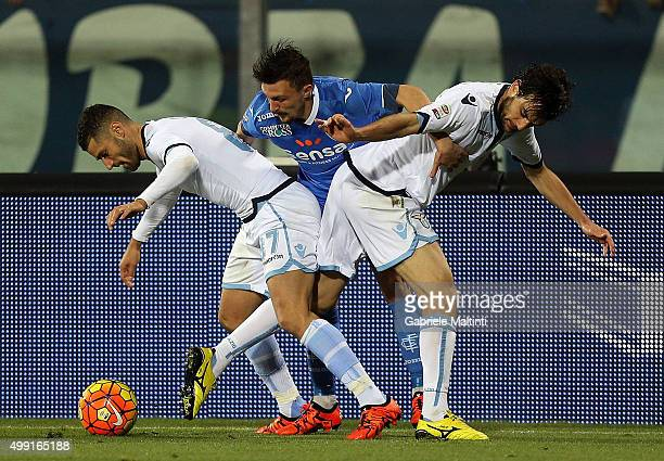 Mario Rui of Empoli FC battles for the ball with Antonio Candreva and Marco Parolo of SS Lazio during the Serie A match between Empoli FC and SS...