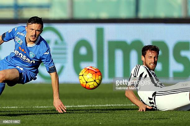 Mario Rui of Empoli FC battles for the ball with Claudio Marchisio of Juventus FC during the Serie A matah between Empoli FC and Juventus FC at...
