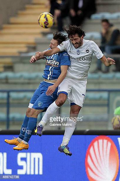 Mario Rui of Empoli FC battles for the ball with Cristian Raimondi of Atalanta BC during the Serie A match between Empoli FC and Atalanta BC at...