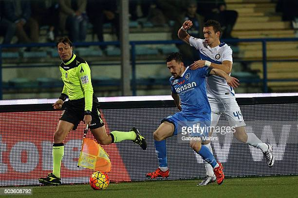 Mario Rui of Empoli FC battles for the ball with Ican Perisic of FC Internazionale Milano during the Serie A match between Empoli FC and FC...