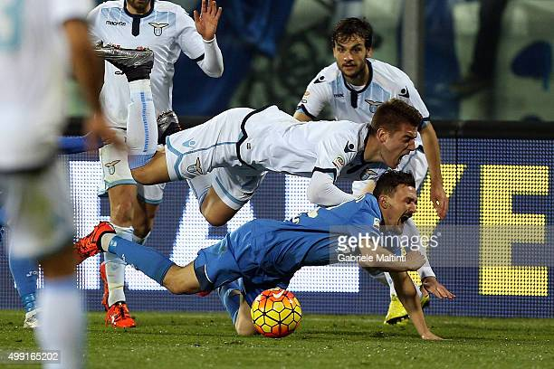 Mario Rui of Empoli FC battles for the ball with Sergej SavicMilinkovic of SS Lazio during the Serie A match between Empoli FC and SS Lazio at Stadio...