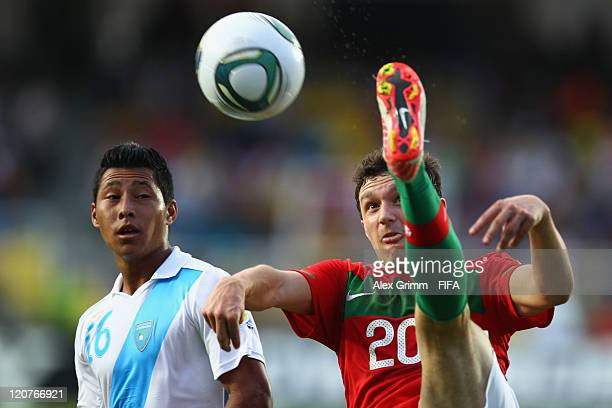 Mario Rui of Portugal is challenged by Cristian Lima of Guatemala during the FIFA U20 World Cup 2011 round of 16 match between Portugal and Guatemala...
