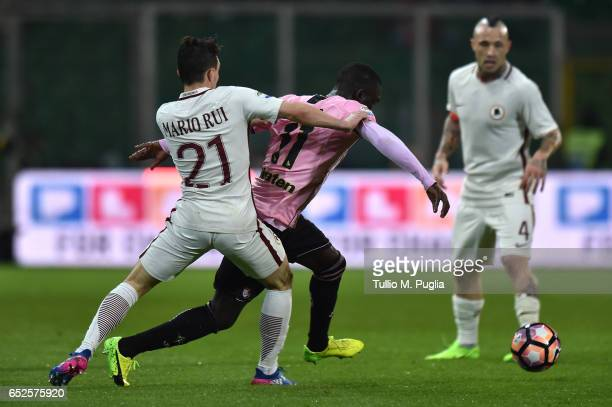 Mario Rui of Roma and Carlos Embalo of Palermo compete for the ball during the Serie A match between US Citta di Palermo and AS Roma at Stadio Renzo...