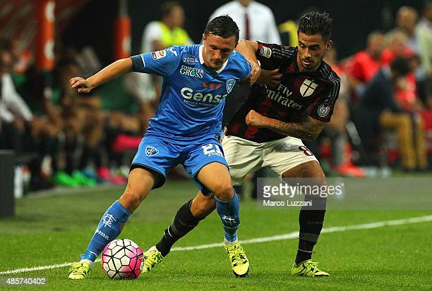 Mario Rui Silva Duarte of Empoli FC competes for the ball with Jesus Joaquin Fernandez Saenz Suso of AC Milan during the Serie A match between AC...