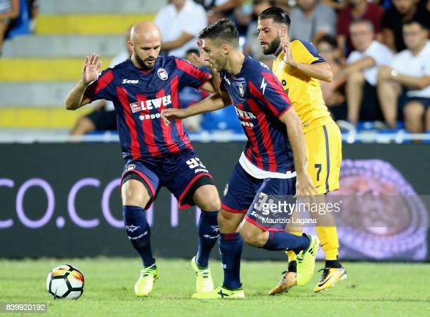 Mario Sampirisi of Crotone competes for the ball with Daniele Verde of Verona during the Serie A match between FC Crotone and Hellas Verona FC at...