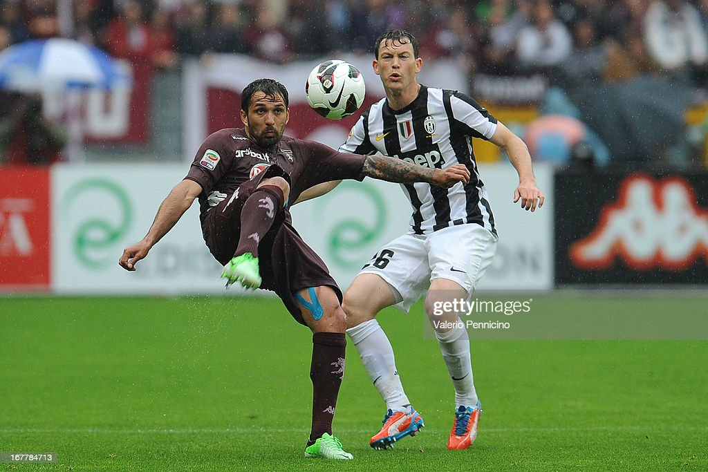 Mario Santana (L) of Torino FC in action against Stephan Lichtsteiner of Juventus during the Serie A match between Torino FC and Juventus at Stadio Olimpico di Torino on April 28, 2013 in Turin, Italy.