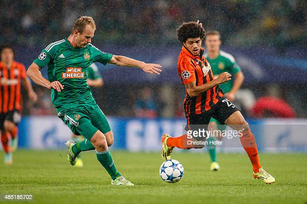 Mario Sonnleitner of Vienna competes for the ball with Taison of Donetsk during the UEFA Champions League Qualifying Round Play Off First Leg match...