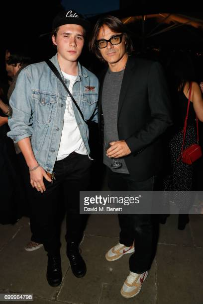 Mario Sorrenti and Brooklyn Beckham attend Kate Moss Mario Sorrenti launch of the OBSESSED Calvin Klein fragrance at Spencer House on June 22 2017 in...