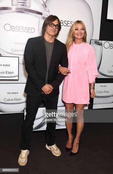 Mario Sorrenti and Kate Moss attend the Kate Moss Mario Sorrenti launch of the OBSESSED Calvin Klein fragrance at Spencer House on June 22 2017 in...