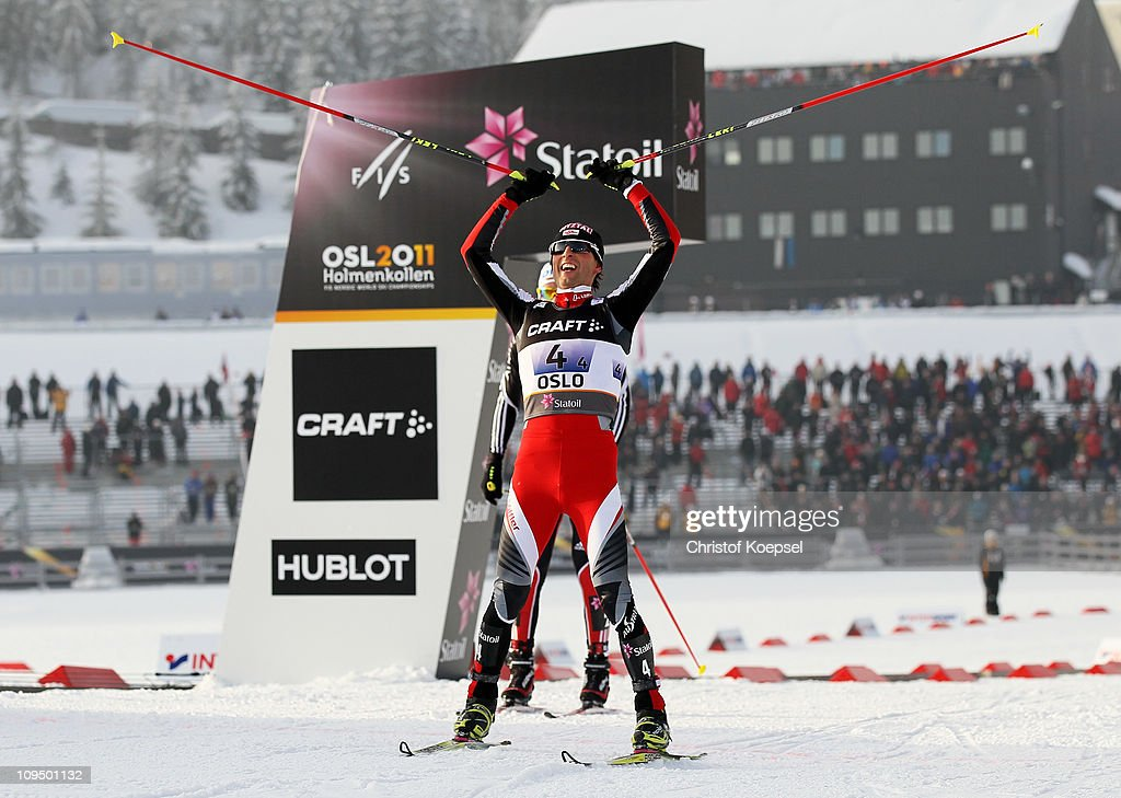 <a gi-track='captionPersonalityLinkClicked' href=/galleries/search?phrase=Mario+Stecher&family=editorial&specificpeople=724611 ng-click='$event.stopPropagation()'>Mario Stecher</a> of Austria celebrates as he crosses the finish line ahead of Tino Edelmann of Germany to win the gold medal in the Nordic Combined Team 4x5km race during the FIS Nordic World Ski Championships at Holmenkollen on February 28, 2011 in Oslo, Norway.