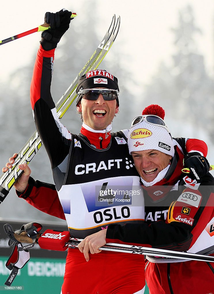 <a gi-track='captionPersonalityLinkClicked' href=/galleries/search?phrase=Mario+Stecher&family=editorial&specificpeople=724611 ng-click='$event.stopPropagation()'>Mario Stecher</a> (L) of Austria celebrates with teammate <a gi-track='captionPersonalityLinkClicked' href=/galleries/search?phrase=David+Kreiner&family=editorial&specificpeople=845144 ng-click='$event.stopPropagation()'>David Kreiner</a> after winning the gold medal in the Nordic Combined Team 4x5km race during the FIS Nordic World Ski Championships at Holmenkollen on February 28, 2011 in Oslo, Norway.