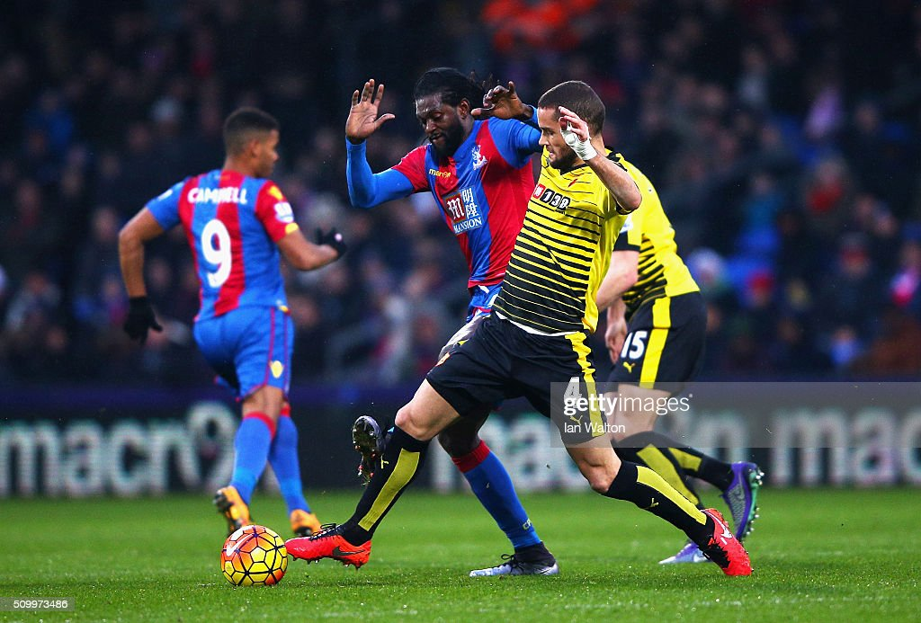 Mario Suarez of Watford and Emmanuel Adebayor of Crystal Palace compete for the ball during the Barclays Premier League match between Crystal Palace and Watford at Selhurst Park on February 13, 2016 in London, England.