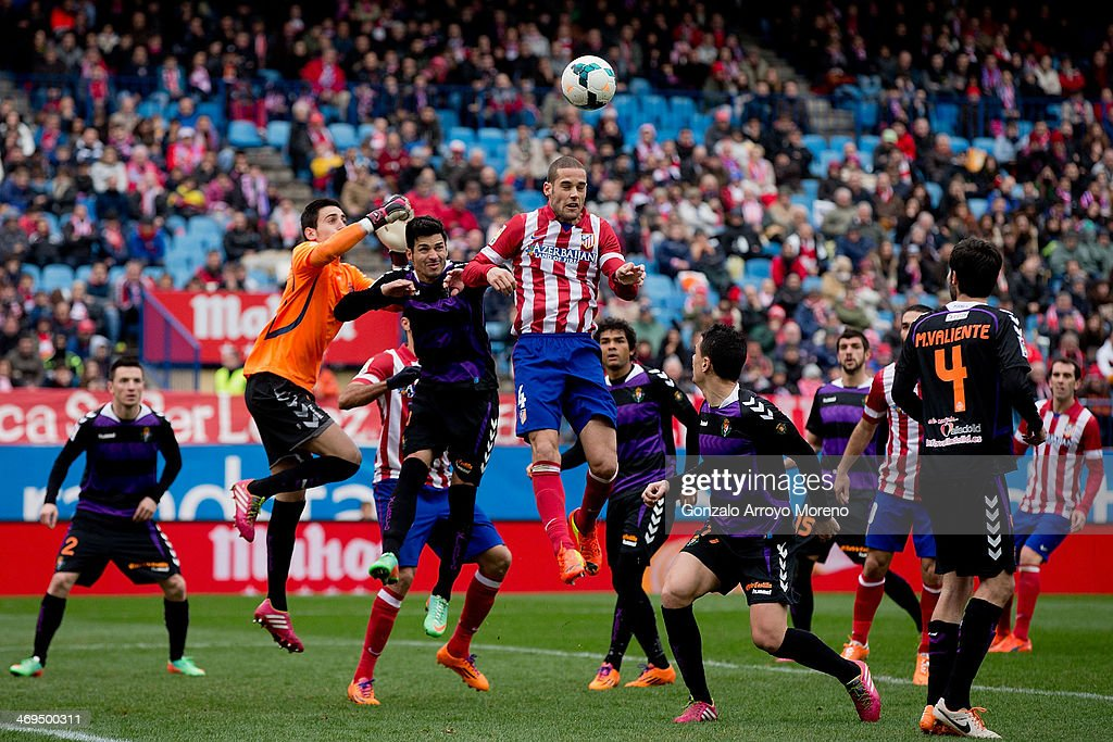 Mario Suarez wins the header after Javier Guerra (2L) and goalkeeper Diego Marino (L) during the La Liga match between Club Atletico de Madrid and Real Valladolid CF at Vicente Calderon Stadium on February 15, 2014 in Madrid, Spain.