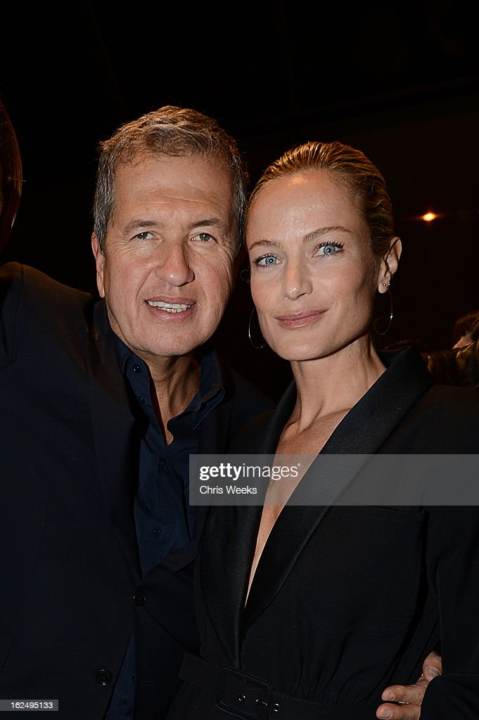 <a gi-track='captionPersonalityLinkClicked' href=/galleries/search?phrase=Mario+Testino&family=editorial&specificpeople=203087 ng-click='$event.stopPropagation()'>Mario Testino</a> and actress <a gi-track='captionPersonalityLinkClicked' href=/galleries/search?phrase=Carolyn+Murphy&family=editorial&specificpeople=211177 ng-click='$event.stopPropagation()'>Carolyn Murphy</a> attend a Private Reception For <a gi-track='captionPersonalityLinkClicked' href=/galleries/search?phrase=Mario+Testino&family=editorial&specificpeople=203087 ng-click='$event.stopPropagation()'>Mario Testino</a> at PRISMon February 23, 2013 in West Hollywood, California.
