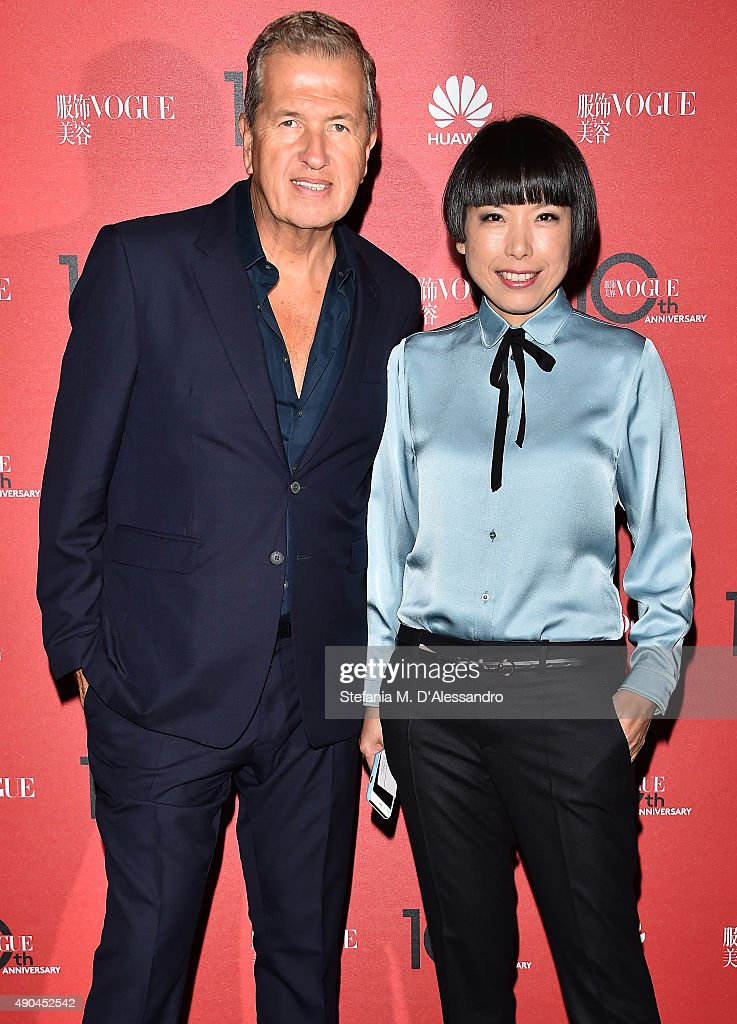 Mario Testino and Angelica Cheung attend Vogue China 10th Anniversary at Palazzo Reale on September 28 2015 in Milan Italy