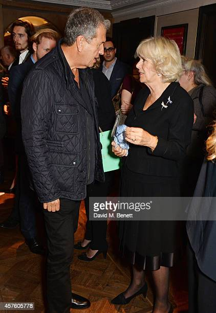Mario Testino and Camilla Duchess of Cornwall attend Fortnum Mason's Diamond Jubilee Tea Salon for the launch of Tom Parker Bowles' new book 'Let's...