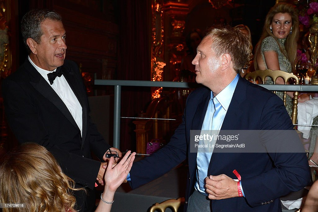 Mario Testino (L) and Dmitry Shumkov attend the dinner at the 'Love Ball' hosted by Natalia Vodianova in support of The Naked Heart Foundation at Opera Garnier on July 27, 2013 in Monaco, Monaco.