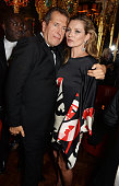 Mario Testino and Kate Moss attend a party in celebration of Edward Enninful in The Oscar Wilde Bar Hotel Cafe Royal on December 1 2014 in London...