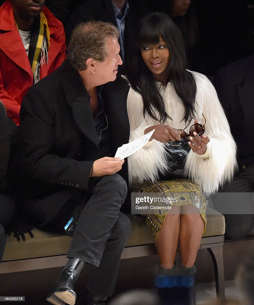 Mario Testino and Naomi Campbell attend the Burberry Prorsum AW 2015 show during London Fashion Week at Kensington Gardens on February 23 2015 in...