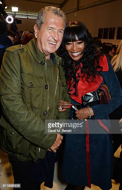 Mario Testino and Naomi Campbell wearing Burberry at the Burberry Womenswear February 2016 Show at Kensington Gardens on February 22 2016 in London...