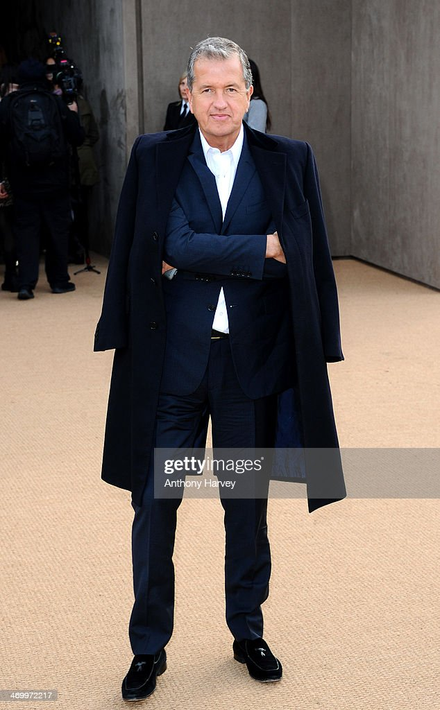 Mario Testino attends the Burberry Prorsum show at London Fashion Week AW14 at Kensington Gardens on February 17, 2014 in London, England.