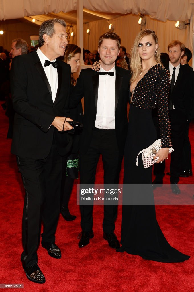 Mario Testino, Christopher Bailey, and Cara Delevingne attend the Costume Institute Gala for the 'PUNK: Chaos to Couture' exhibition at the Metropolitan Museum of Art on May 6, 2013 in New York City.
