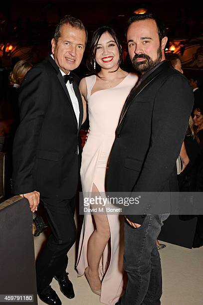 Mario Testino Daisy Lowe and Evgeny Lebedev attend a drinks reception at the British Fashion Awards at the London Coliseum on December 1 2014 in...