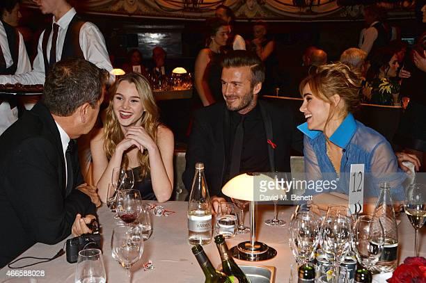Mario Testino Immy Waterhouse David Beckham and Suki Waterhouse attend the British Fashion Awards at the London Coliseum on December 1 2014 in London...