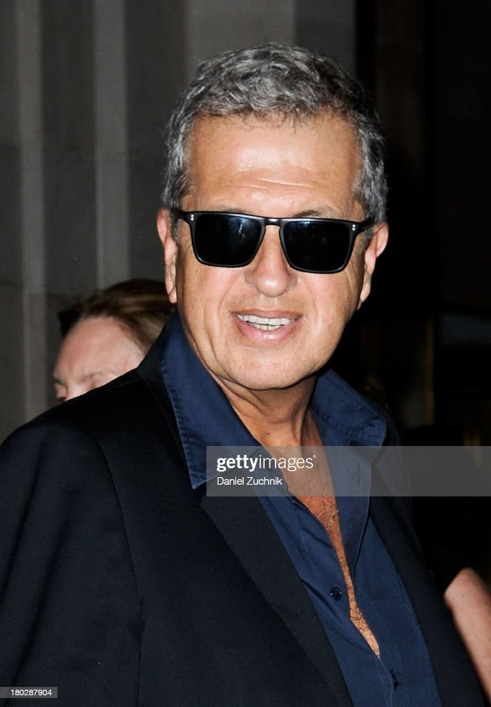 <a gi-track='captionPersonalityLinkClicked' href=/galleries/search?phrase=Mario+Testino&family=editorial&specificpeople=203087 ng-click='$event.stopPropagation()'>Mario Testino</a> is seen outside the Oscar de la Renta show on September 10, 2013 in New York City.