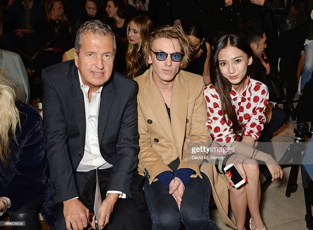 <a gi-track='captionPersonalityLinkClicked' href=/galleries/search?phrase=Mario+Testino&family=editorial&specificpeople=203087 ng-click='$event.stopPropagation()'>Mario Testino</a>, Jamie Campbell Bower and <a gi-track='captionPersonalityLinkClicked' href=/galleries/search?phrase=Angelababy&family=editorial&specificpeople=5922162 ng-click='$event.stopPropagation()'>Angelababy</a> attend the front row at Burberry Womenswear Autumn/Winter 2014 at Kensington Gardens on February 17, 2014 in London, England.