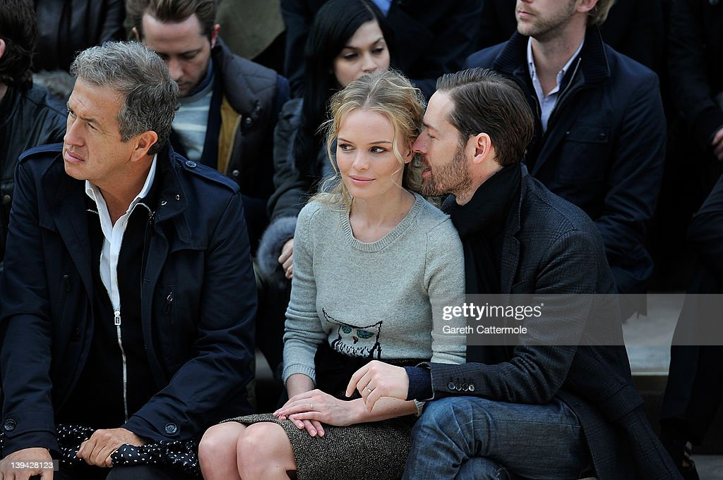 Mario Testino, Kate Bosworth and Michael Polish attend the Burberry Autumn Winter 2012 Womenswear Front Row during London Fashion Week at Kensington Gardens on February 20, 2012 in London, England.