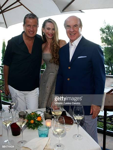 Mario Testino Yvonne Scio and Roberto Scio attend Il Pellicano Summer Party with Jurgen Teller held at the Hotel Il Pellicano on June 13 2009 in...