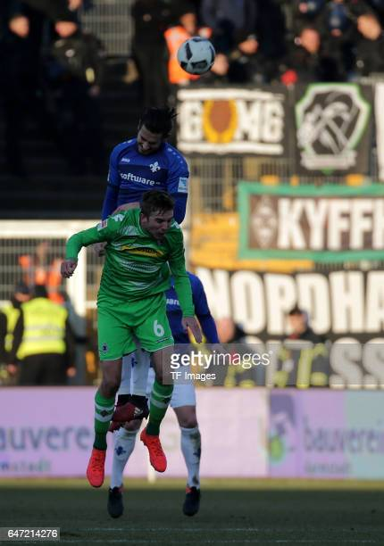 Mario Vrancic of Darmstadt and Christoph Kramer of Gladbach battle for the ball during the Bundesliga match between SV Darmstadt 98 and Borussia...