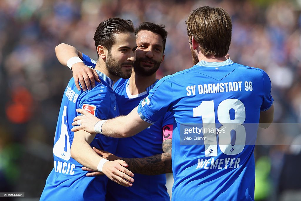 Mario Vrancic of Darmstadt celebrates his team's first goal with team mates Aytac Sulu and Peter Niemeyer (L-R) during the Bundesliga match between SV Darmstadt 98 and Eintracht Frankfurt at Merck-Stadion am Boellenfalltor on April 30, 2016 in Darmstadt, Hesse.