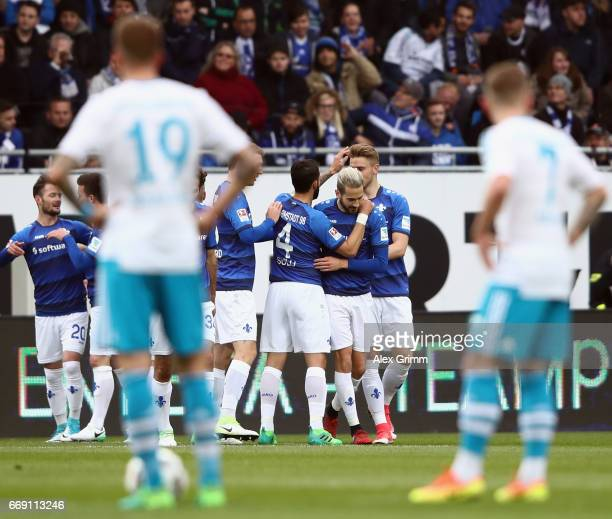 Mario Vrancic of Darmstadt celebrates his team's first goal with team mates during the Bundesliga match between SV Darmstadt 98 and FC Schalke 04 at...