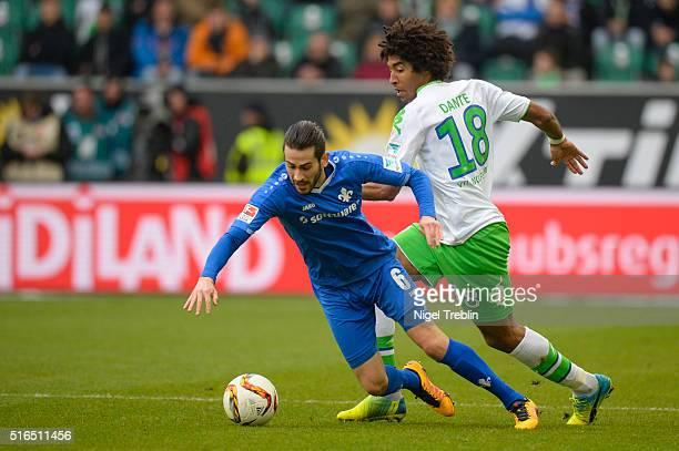Mario Vrancic of Darmstadt is challenged by Dante of Wolfsburg during the Bundesliga match between VfL Wolfsburg and Hertha BSC Berlin at Volkswagen...
