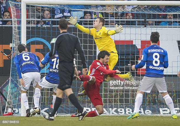 Mario Vrancic of Darmstadt pushs Mats Hummels of Bayern Muenchen during to the Bundesliga match between SV Darmstadt 98 and Bayern Muenchen at...