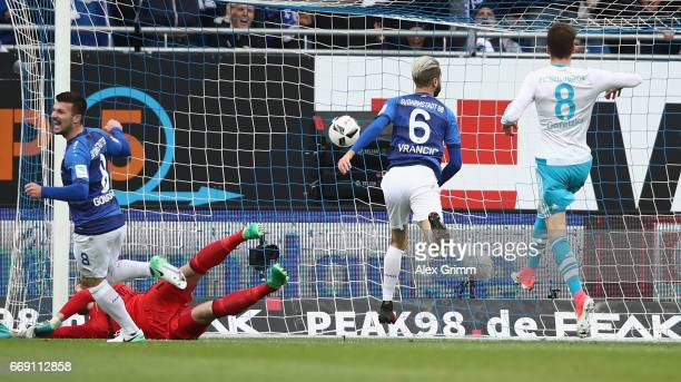 Mario Vrancic of Darmstadt scores his team's first goal past goalkeeper Ralf Faehrmann of Schalke during the Bundesliga match between SV Darmstadt 98...