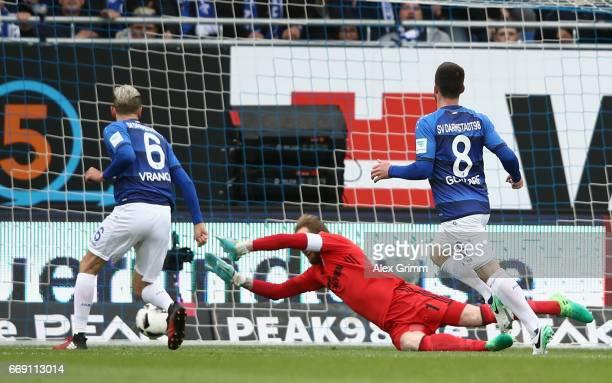 Mario Vrancic of Darmstadt scores his team's first goal past goalkeeper Ralf Faehrmann of Schalke during the Bundesliga match between SV Darmstadt 98...