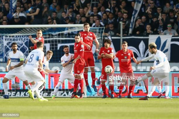 Mario Vrancic of Darmstadt shoots a freekick during the Bundesliga match between SV Darmstadt 98 and 1 FSV Mainz 05 at JonathanHeimesStadion am...