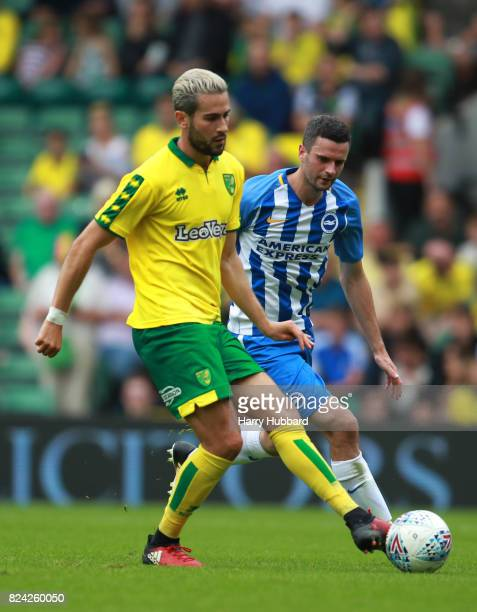 Mario Vrancic of Norwich and Jamie Murphy of Brighton in action during the preseason friendly match between Norwich City and Brighton Hove Albion at...