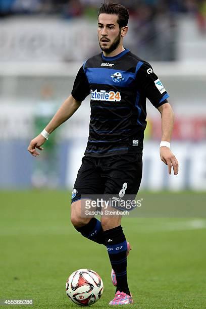 Mario Vrancic of Paderborn runs with the ball during the Bundesliga match between SC Paderborn 07 and 1 FC Koeln at Benteler Arena on September 13...