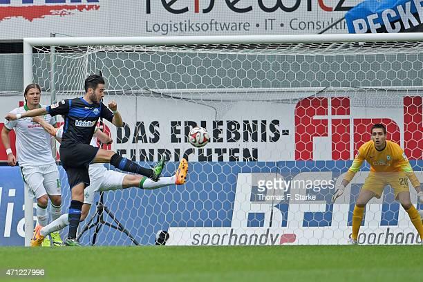 Mario Vrancic of Paderborn scores his teams first goal against goalkeeper Koen Casteels of Bremen during the Bundesliga match between SC Paderborn...