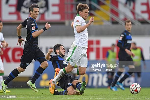 Mario Vrancic of Paderborn tackles Clemens Fritz of Bremen during the Bundesliga match between SC Paderborn and SV Werder Bremen at Benteler Arena on...