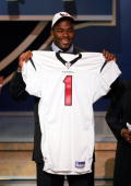 Mario Williams A defensive end from North Carolina State holds up a jersey after being selected as the first pick of the 2006 NFL Draft by the...