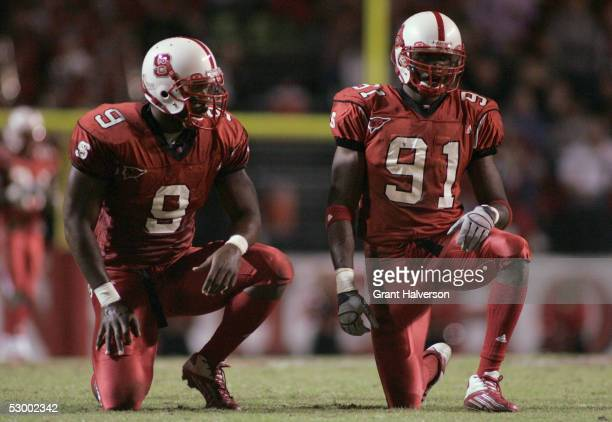 Mario Williams and Manny Lawson of the North Carolina State Wolfpack line up against the Florida State Seminoles during an ACC game at CarterFinley...