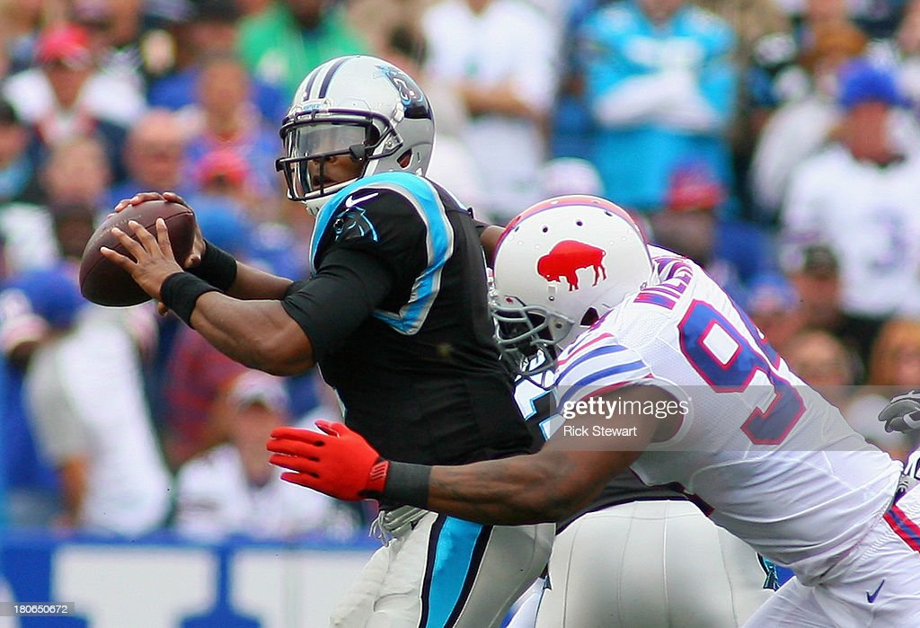 <a gi-track='captionPersonalityLinkClicked' href=/galleries/search?phrase=Mario+Williams&family=editorial&specificpeople=601811 ng-click='$event.stopPropagation()'>Mario Williams</a> #94 of the Buffalo Bills sacks <a gi-track='captionPersonalityLinkClicked' href=/galleries/search?phrase=Cam+Newton+-+American+Football+Quarterback&family=editorial&specificpeople=4516761 ng-click='$event.stopPropagation()'>Cam Newton</a> #1 of the Carolina Panthers at Ralph Wilson Stadium on September 15, 2013 in Orchard Park, New York. Buffalo won 24-23.