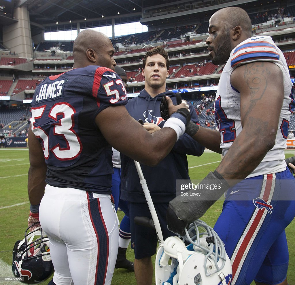 <a gi-track='captionPersonalityLinkClicked' href=/galleries/search?phrase=Mario+Williams&family=editorial&specificpeople=601811 ng-click='$event.stopPropagation()'>Mario Williams</a> #94 of the Buffalo Bills shakes hands with <a gi-track='captionPersonalityLinkClicked' href=/galleries/search?phrase=Bradie+James&family=editorial&specificpeople=756554 ng-click='$event.stopPropagation()'>Bradie James</a> #53 of the Houston Texans and injured <a gi-track='captionPersonalityLinkClicked' href=/galleries/search?phrase=Brian+Cushing&family=editorial&specificpeople=2107368 ng-click='$event.stopPropagation()'>Brian Cushing</a> at Reliant Stadium on November 4, 2012 in Houston, Texas. Houston defeated Buffalo 21-9.